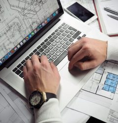 Looking at building designs on laptop